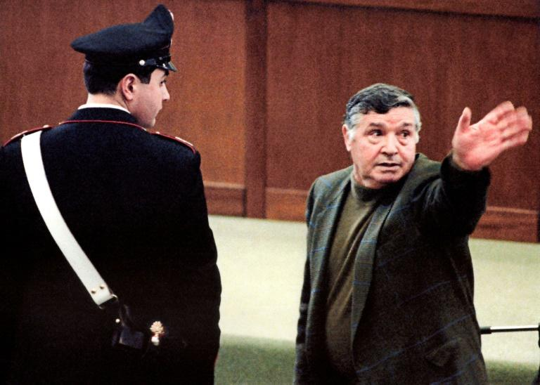 "Salvatore ""Toto"" Riina during his trial at a high-security prison in Palermo, Italy, in March 1993"