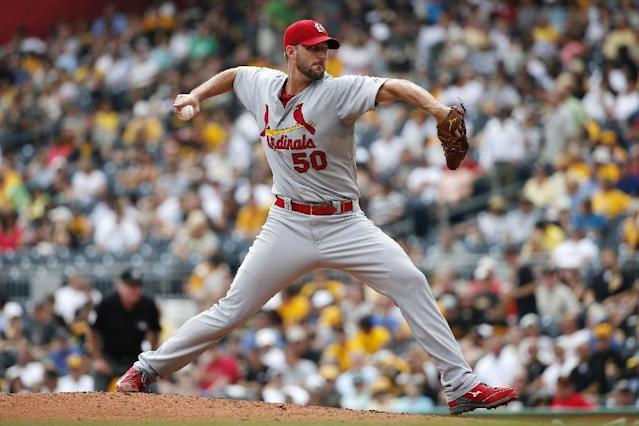 St. Louis Cardinals' Adam Wainwright delivers during the second inning of a baseball game against the Pittsburgh Pirates in Pittsburgh Wednesday, Aug. 27, 2014. (AP Photo/Gene J. Puskar)