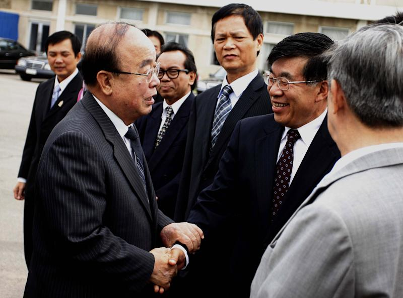 North Korean Foreign Minister Pak Ui Chun, left, shakes hands with Chinese Ambassador to North Korea Liu Hongcai at Pyongyang airport, North Korea, Saturday, June 29, 2013 before leaving for Brunei to attend the ASEAN foreign ministers meeting. The regional security summit in Brunei is the sort of venue where North Korea has often managed to open up sideline discussions with Seoul and Washington. This time, while there will be plenty of talk about Pyongyang, there is little chance of substantive talk with it. (AP Photo/Kim Kwang Hyon)
