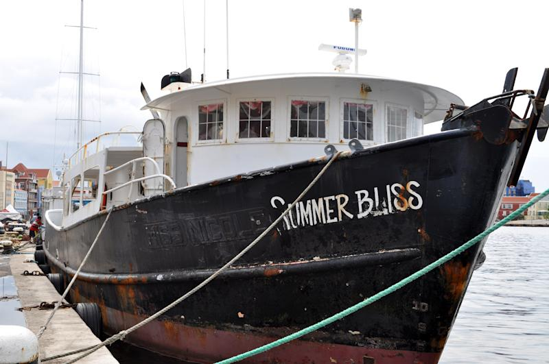 """The """"Summer Bliss"""" fishing boat sits docked at the Willemstad port in Curacao, Friday, Nov. 30, 2012. Masked men in jackets emblazoned with the word """"police"""" boarded the """"Summer Bliss"""" in an early morning assault on Friday and stole 70 gold bars worth an estimated $11.5 million, police spokesman Reggie Huggins said. He declined to say who owned the approximately 216 kilograms (476 pounds) of gold but he said it was a legal shipment that was being transshipped through Curacao and officials in the island had been advised in advance that it was coming as part of normal security protocols. (AP Photo/Karen Attiah)"""