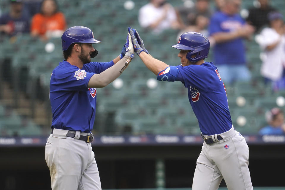 Chicago Cubs' Matt Duffy, right, celebrates his three-run home run with Kris Bryant in the fifth inning of a baseball game against the Detroit Tigers in Detroit, Saturday, May 15, 2021. (AP Photo/Paul Sancya)