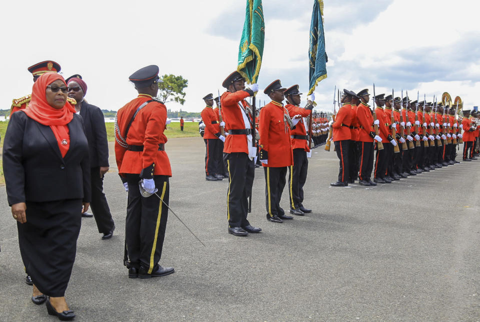 Tanzania's new president Samia Suluhu Hassan, left, inspects the guard of honor after being sworn in at a ceremony at State House in Dar es Salaam, Tanzania Friday, March 19, 2021. Samia Suluhu Hassan made history Friday when she was sworn in as Tanzania's first female president, following the death of her predecessor John Magufuli. (AP Photo)