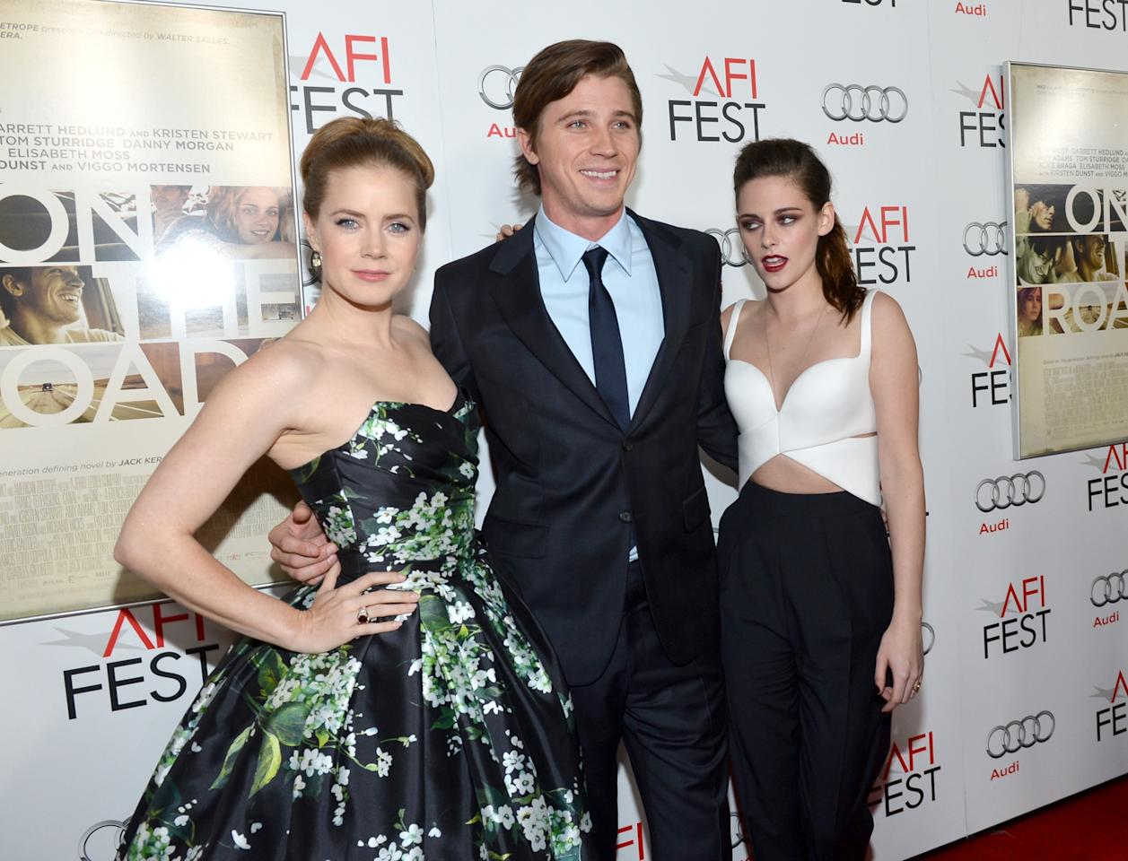 """HOLLYWOOD, CA - NOVEMBER 03:  (L-R) Actors Amy Adams, Garrett Hedlund, and Kristen Stewart arrives at the """"On The Road"""" premiere during the 2012 AFI Fest presented by Audi at Grauman's Chinese Theatre on November 3, 2012 in Hollywood, California.  (Photo by Alberto E. Rodriguez/Getty Images for AFI)"""