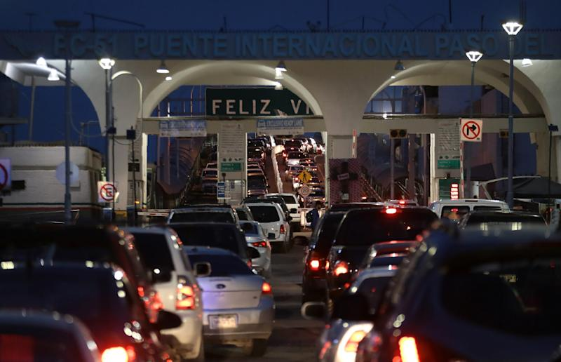 """JUAREZ, Mexico – A sign that reads """"Feliz Viaje,"""" or """"Have a Good Trip,"""" greets motorists who have waited hours at the Paso del Norte International Bridge between El Paso, Texas, and Juarez on June, 28, 2019."""