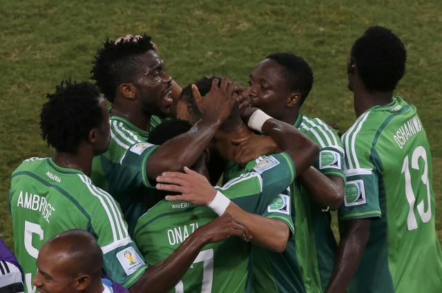 Nigeria's Peter Odemwingie celebrates with teammates after scoring a goal during the 2014 World Cup Group F soccer match between Nigeria and Bosnia at the Pantanal arena in Cuiaba June 21, 2014 REUTERS/Suhaib Salem (BRAZIL - Tags: TPX IMAGES OF THE DAY SOCCER SPORT WORLD CUP)