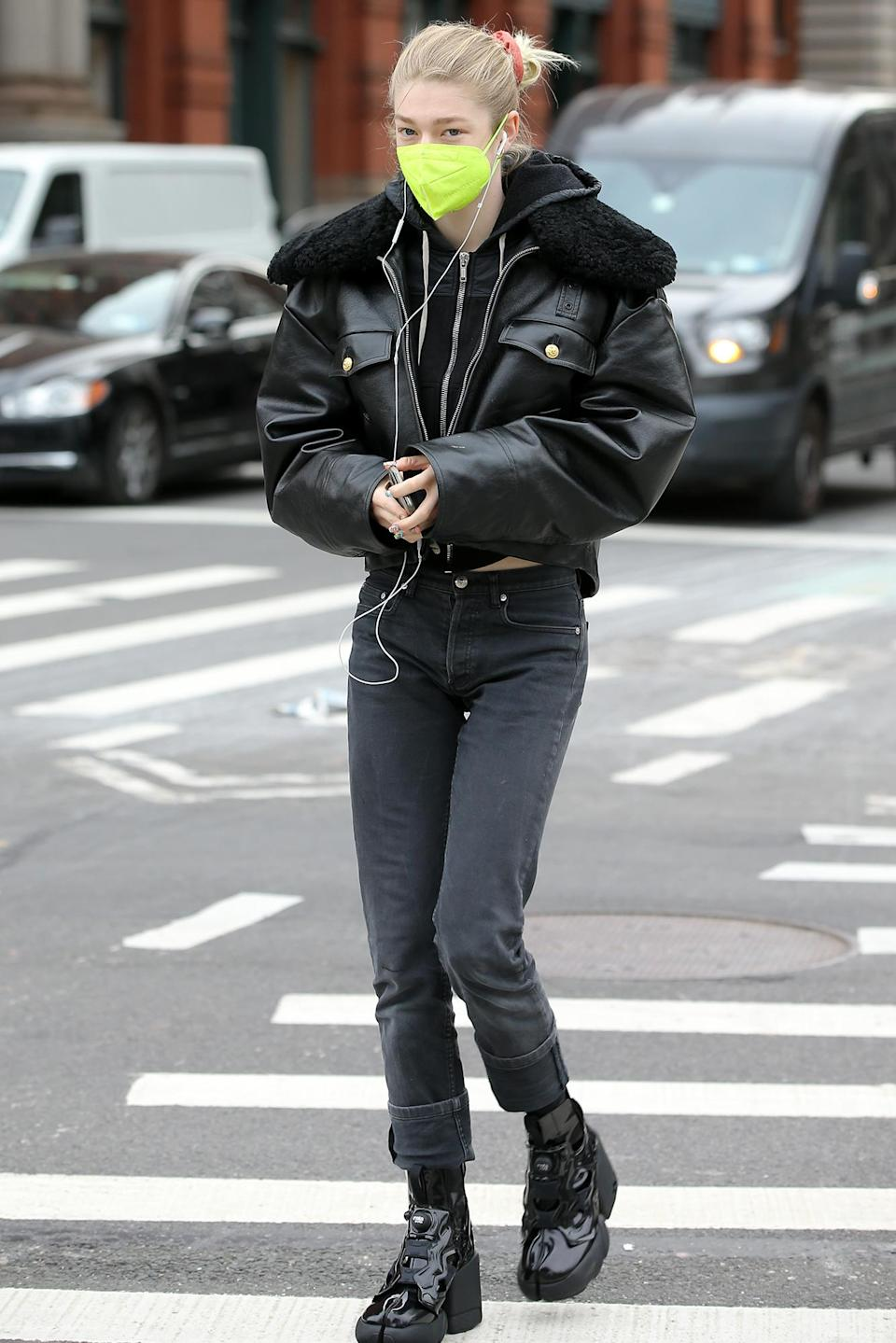<p><em>Euphoria</em> star Hunter Schafer steps out in all black and a neon green mask on Monday in N.Y.C.</p>