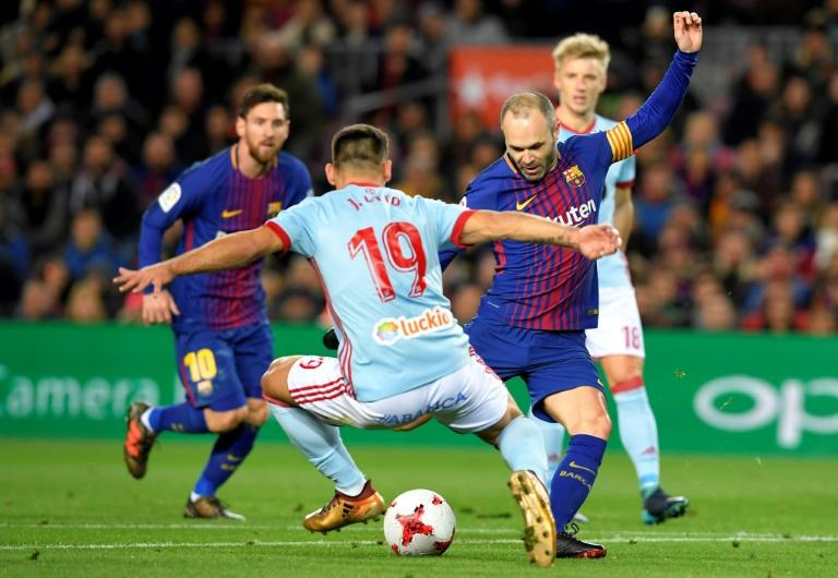 Barcelona's Andres Iniesta (R) fights for the ball with Celta Vigo's Jonny Castro during their Spanish Copa del Rey round of 16 second leg match, at the Camp Nou stadium in Barcelona, on January 11, 2018