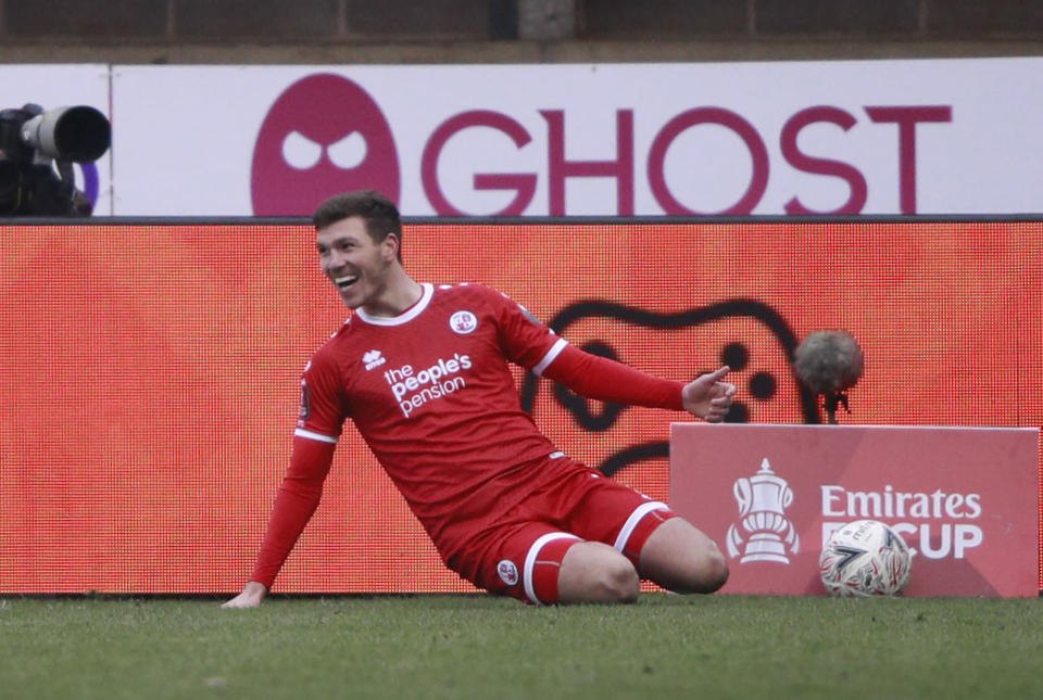 Crawley Town's Jordan Tunnicliffe celebrates after scoring his side's third goal during the English FA Cup third round soccer match between Crawley Town and Leeds United at Broadfield Stadium in Crawley, England, Sunday, Jan. 10, 2021. (AP Photo/Ian Walton)