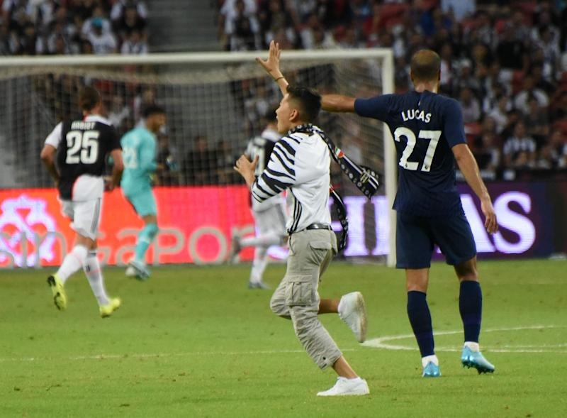 A young pitch invader disrupted the International Champions Cup match between Juventus and Tottenham at the National Stadium. (PHOTO: Zainal Yahya/Yahoo News Singapore)