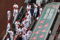 Members of the St. Louis Cardinals wait to be introduced before the start of a baseball game against the Pittsburgh Pirates Friday, July 24, 2020, in St. Louis. (AP Photo/Jeff Roberson)