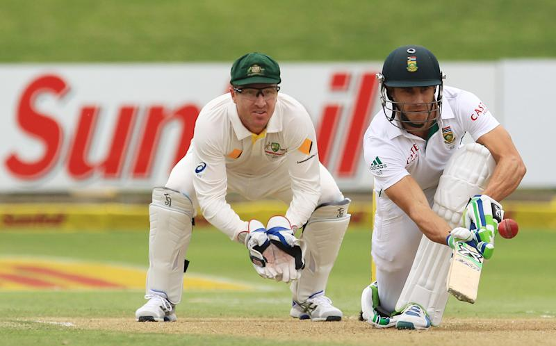 South Africa's batsman Faf du Plessis, right, chips the ball as Australia's wicketkeeper Brad Haddin, left, watches on the first day of their 2nd cricket test match at St George's Park in Port Elizabeth, South Africa, Thursday, Feb. 20, 2014. (AP Photo/ Themba Hadebe)