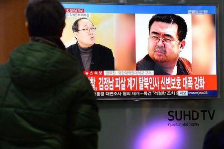 People watch a TV screen broadcasting a news report on the assassination of Kim Jong Nam, the older half brother of the North Korean leader Kim Jong Un, at a railway station in Seoul