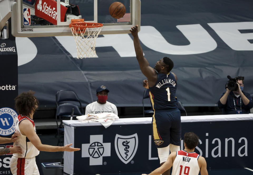 New Orleans Pelicans forward Zion Williamson (1) shoots over Washington Wizards guard Raul Neto (19) in the first quarter of an NBA basketball game in New Orleans, Wednesday, Jan. 27, 2021. (AP Photo/Derick Hingle)