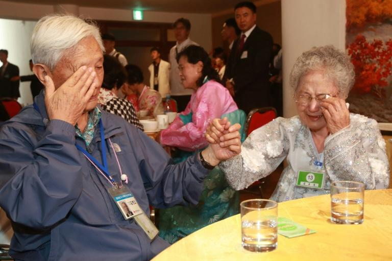 South Korean Kim Byung-oh (L), 88, cries with his North Korean sister Kim Sun Ok, 81, as they bid farewell