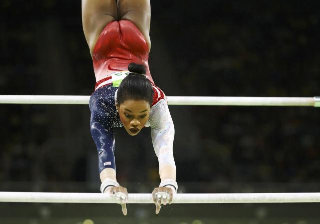 2016 Rio Olympics - Artistic Gymnastics - Final - Women's Team Final - Rio Olympic Arena - Rio de Janeiro, Brazil - 09/08/2016. Gabrielle Douglas (USA) of USA (Gabby Douglas) competes on the uneven bars during the women's team final. REUTERS/Mike Blake FOR EDITORIAL USE ONLY. NOT FOR SALE FOR MARKETING OR ADVERTISING CAMPAIGNS.