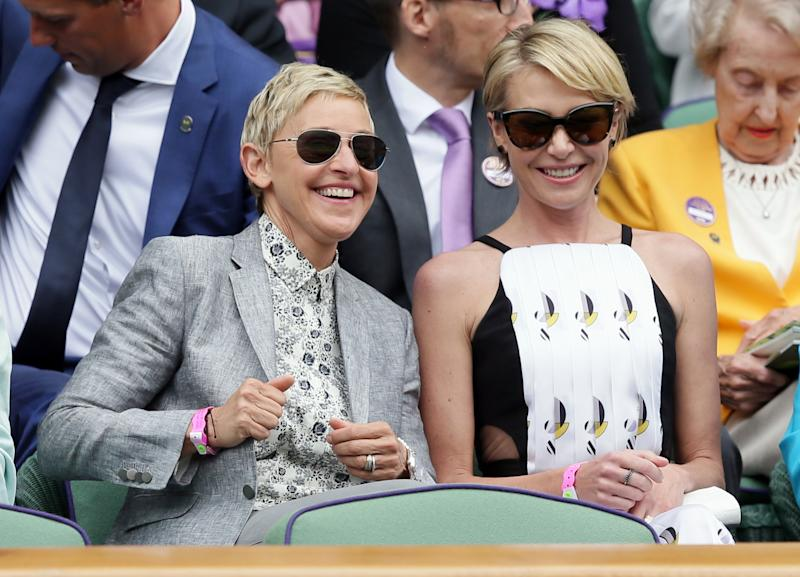 Ellen DeGeneres, left, and her wife Portia de Rossi sit in the Royal Box on day thirteen of the Wimbledon Tennis Championships in London, Saturday, July 9, 2016. (AP Photo/Tim Ireland)