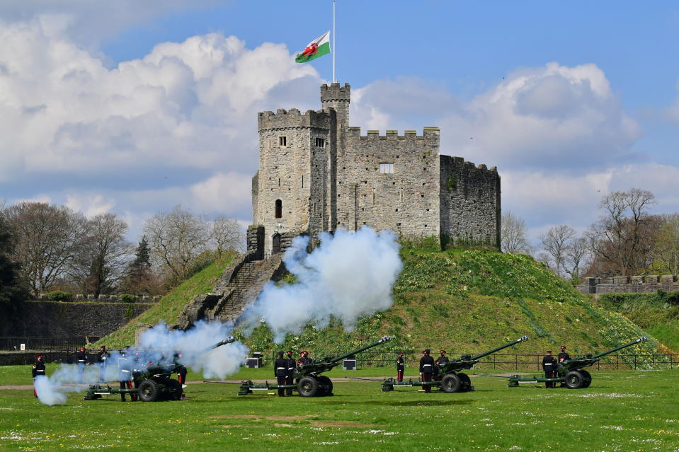 Members of the 104th Regiment Royal Artillery fire a 41-round gun salute in the grounds of Cardiff Castle, to mark the death of Prince Philip, in Cardiff, Saturday, April 10, 2021. Britain's Prince Philip, the irascible and tough-minded husband of Queen Elizabeth II who spent more than seven decades supporting his wife in a role that mostly defined his life, died on Friday. (Ben Birchall/PA via AP)