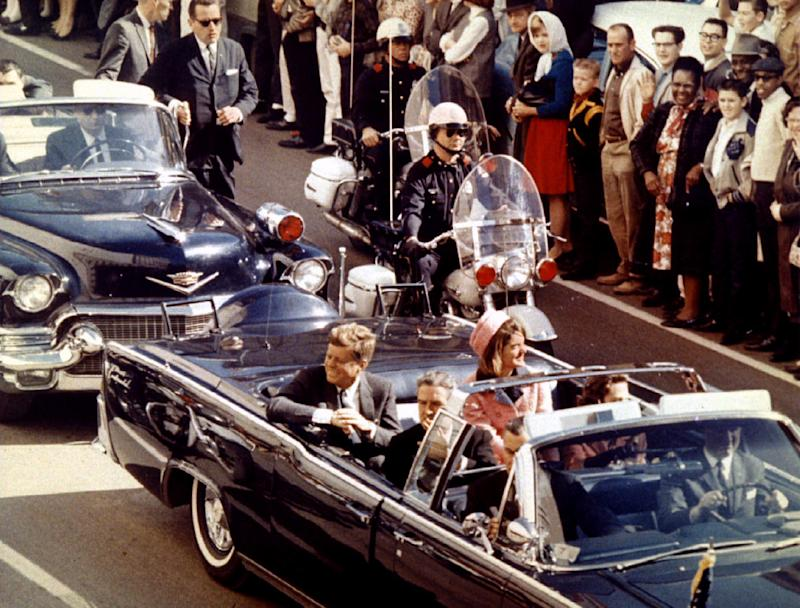 President and Mrs. John F. Kennedy, and Texas Governor John Connally ride through Dallas moments before Kennedy was assassinated, November 22, 1963. (STR New / Reuters)
