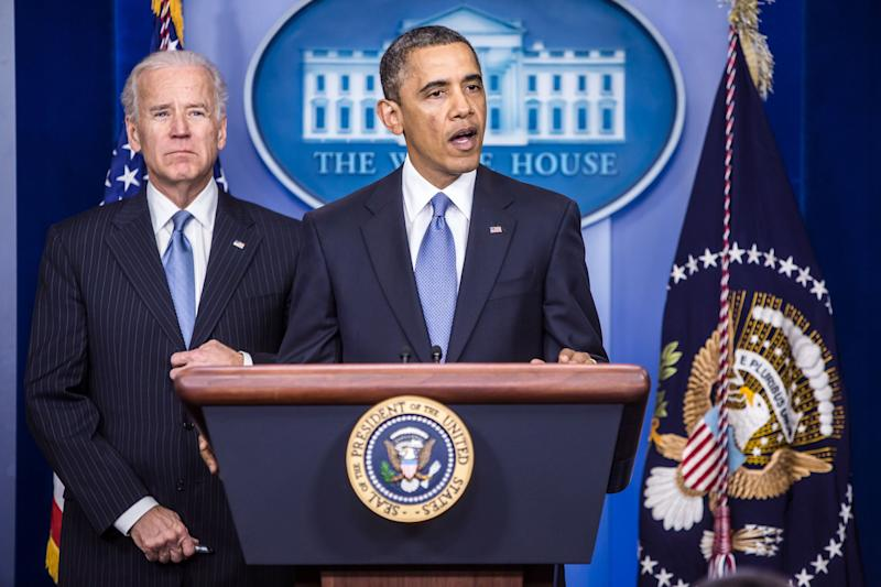 Obama, right, speaks as Biden looks on in the Brady Press Briefing Room at the White House on Jan. 1, 2013.