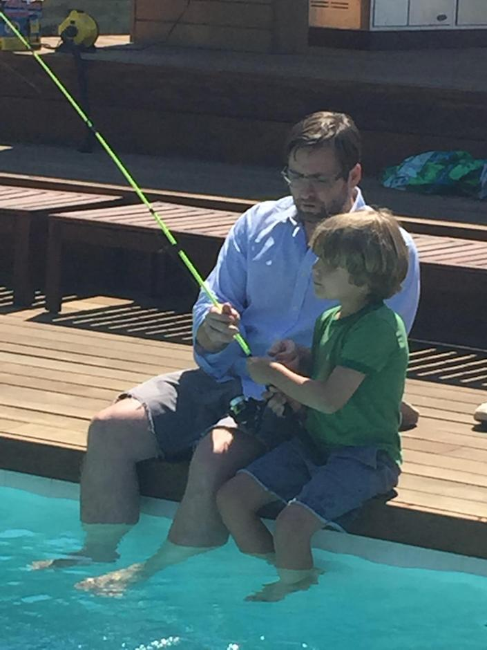<p>Laura's husband, Brian Schmidt, practices fishing skills with their son, Anton, in the backyard pool.<br></p>