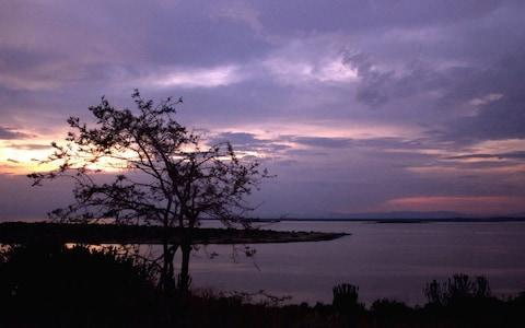 <span>The sun sets over Lake George near Uganda's Queen Elizabeth National Park in western Uganda,</span>