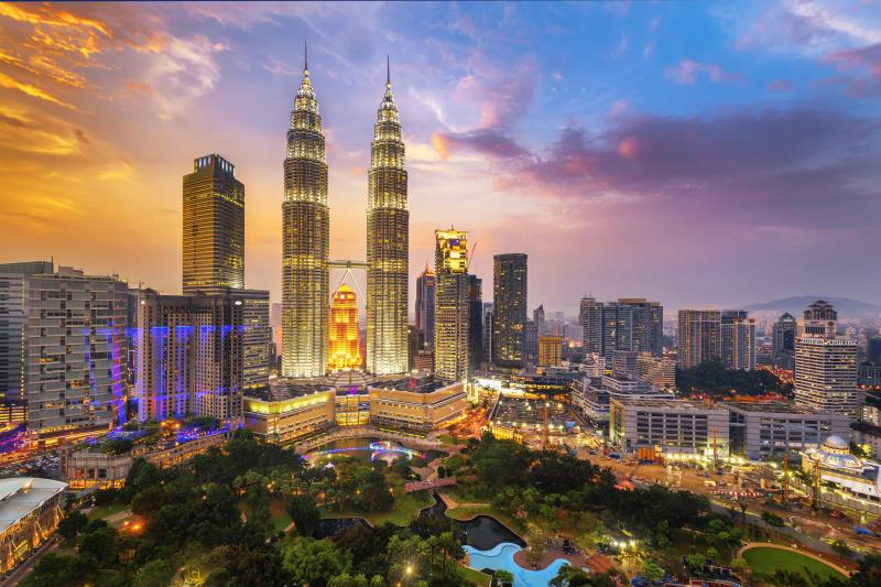 The Petronas Twin Towers on February 12, 2014, in Kuala Lumpur, Malaysia are the world's tallest twin tower. The skyscraper height is 451.9m