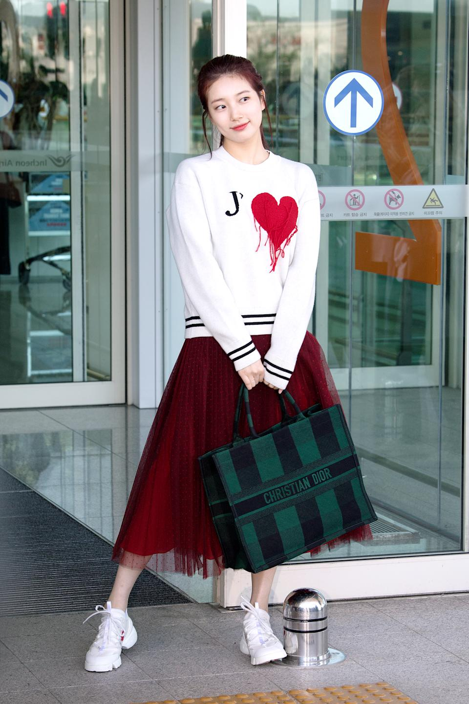 Korean celebrity Suzy Bae (@skuukzky) wearing Dior outfits, D-Connect sneakers and FW2019 Dior Book Tote bag. (PHOTO: Dior)