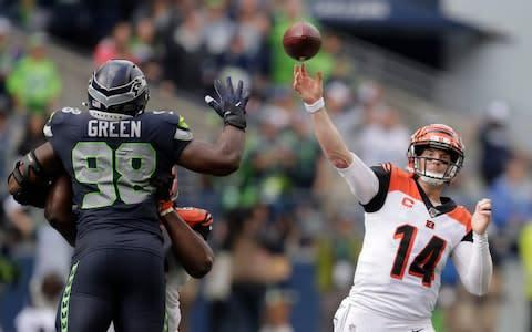 <span>Andy Dalton passed for more than 400 yards against the Seahawks</span> <span>Credit: AP </span>