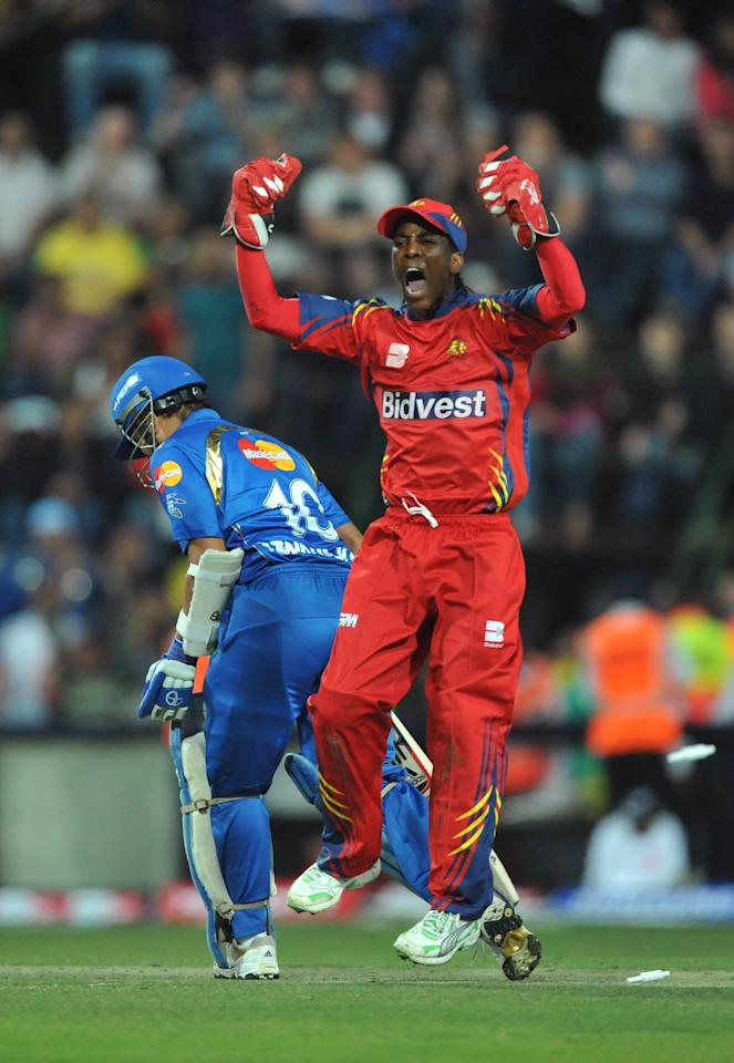 JOHANNESBURG, SOUTH AFRICA - SEPTEMBER 10:  Thami Tsolekile of the Highveld Lions celebrates the wicket of Sachin Tendulkar of the Mumbai Indians for 69 runs during the Airtel Champions League Twenty20 match between Mumbai Indians and Highveld Lions at Wanderers Stadium on September 10, 2010 in Johannesburg, South Africa.  (Photo by Duif du Toit/Gallo Images/Getty Images)