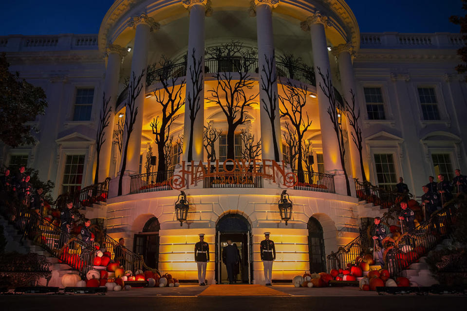 In this Oct. 28, 2019 file photo, President Donald Trump and first lady Melania Trump depart after giving candy to children during a Halloween trick-or-treat event on the South Lawn of the White House in Washington, which is decorated for Halloween. Melania Trump announced Friday that ghosts and goblins are welcome to trick or treat at the White House on Sunday during a Halloween event that has been rejiggered to include coronavirus precautions. President Donald Trump and the first lady — both recently recovered from COVID-19, the disease brought on by the coronavirus — will welcome guests. (AP Photo/Alex Brandon)