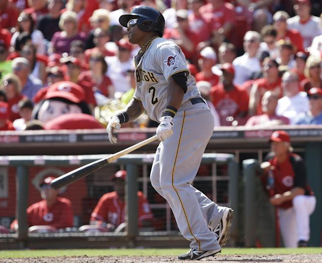 Pittsburgh Pirates' Marlon Byrd watches his two-run home run off Cincinnati Reds starting pitcher Bronson Arroyo in the fifth inning of a baseball game, Saturday, Sept. 28, 2013, in Cincinnati. (AP Photo/Al Behrman)