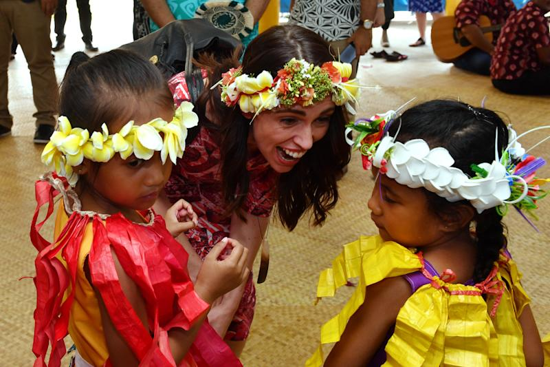 New Zealand's Prime Minister Jacinda Ardern is welcomed by children as she arrives for the Pacific Islands Forum in Funafuti, Tuvalu, Wednesday, August 14, 2019. (AAP Image/Mick Tsikas) NO ARCHIVING