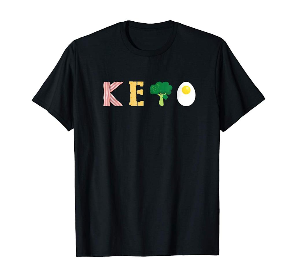"<p>They'll get a kick out of this <a href=""https://www.popsugar.com/buy/Awesome-Workout-Keto-Tee-Shirt-508317?p_name=Awesome%20Workout%20Keto%20Tee%20Shirt&retailer=amazon.com&pid=508317&price=17&evar1=fit%3Aus&evar9=45413210&evar98=https%3A%2F%2Fwww.popsugar.com%2Fphoto-gallery%2F45413210%2Fimage%2F46823507%2FAwesome-Workout-Keto-Tee-Shirt&list1=shopping%2Cgifts%2Camazon%2Choliday%2Chealthy%20snacks%2Csnacks%2Cstocking%20stuffers%2Cgift%20guide%2Chealthy%20living%2Cfood%20shopping%2Cgifts%20for%20women%2Cgifts%20for%20men%2Cgifts%20under%20%24100%2Cgifts%20under%20%2450%2Cgifts%20under%20%2475%2Cketo%20diet&prop13=api&pdata=1"" rel=""nofollow"" data-shoppable-link=""1"" target=""_blank"" class=""ga-track"" data-ga-category=""Related"" data-ga-label=""https://www.amazon.com/Awesome-Workout-Gifts-Women-Shirts/dp/B07D457CK1/ref=sr_1_40?dchild=1&amp;keywords=keto+gifts&amp;qid=1572374918&amp;sr=8-40"" data-ga-action=""In-Line Links"">Awesome Workout Keto Tee Shirt</a> ($17).</p>"