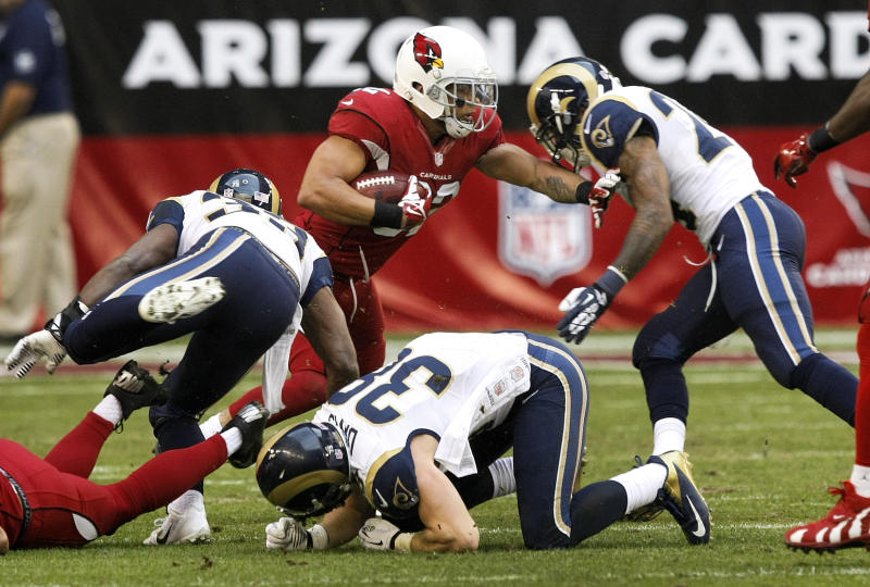 Arizona Cardinals free safety Tyrann Mathieu (32) is hit by St. Louis Rams defensive back Cody Davis (38), and St. Louis Rams cornerback Quinton Pointer, left, during the second half of an NFL football game, Sunday, Dec. 8, 2013, in Glendale, Ariz. Mathieu was injured on the play and left the game. (AP Photo/Rick Scuteri)