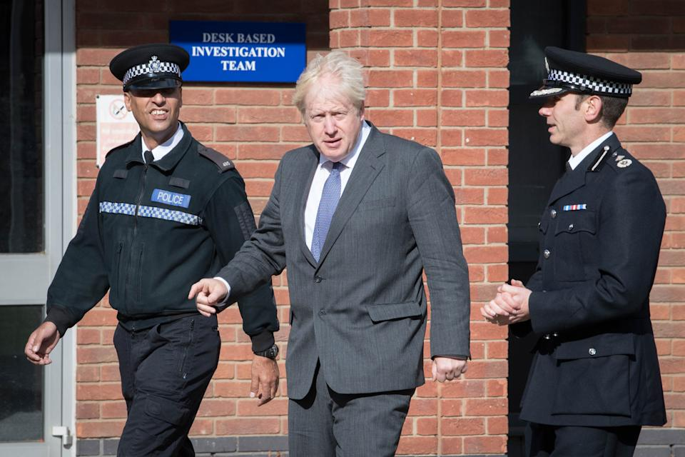 Prime Minister Boris Johnson during a visit to Northamptonshire Police Headquarters in Northampton with Deputy Chief Constable, Simon Nickless (right) where he met new recruits and saw a class training in first aid.