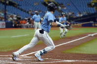 Tampa Bay Rays' Kevin Kiermaier watches his RBI single off Baltimore Orioles pitcher Jorge Lopez during the first inning of a baseball game Saturday, June 12, 2021, in St. Petersburg, Fla. (AP Photo/Chris O'Meara)