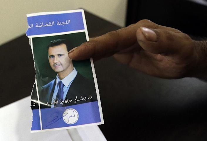 Syria last held a presidential election in 2014, when Bashar al-Assad was re-elected in a controversial poll which was held in the midst of a bitter civil war (AFP Photo/Joseph Eid)