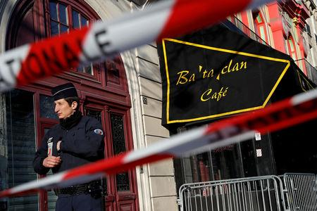 FILE PHOTO: French police block the access to the Bataclan concert hall before the visit of members of a French parliamentary committee investigating government measures to fight shooting and bombing attacks at the site four months after a series of attacks at several sites in Paris, France, March 17, 2016. REUTERS/Benoit Tessier/File Photo