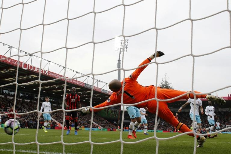 West Ham United's goalkeeper Darren Randolph dives but fails to stop Bournemouth's Joshua King (R) from scoring during their match on March 11, 2017