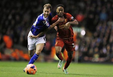 Oldham Athletic's James Dayton challenges Liverpool's Raheem Sterling during their FA Cup third round soccer match at Anfield in Liverpool January 5, 2014. REUTERS/Phil Noble