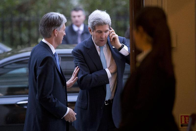 "US Secretary of State John Kerry (C), who has been in London since Monday evening, was due to arrive mid-week in the Austrian capital to complete negotiations with the ""5+1"" group and Tehran"
