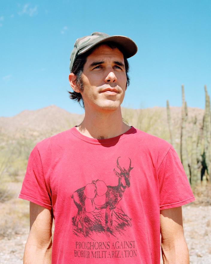 Warren in the desert on the outskirts of Ajo.   Cassidy Araiza for TIME