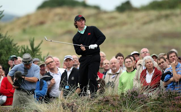 """<div class=""""caption""""> <a class=""""link rapid-noclick-resp"""" href=""""/pga/players/8016/"""" data-ylk=""""slk:Rory McIlroy"""">Rory McIlroy</a> of Northern Ireland plays from the deep rough for their second shot at the 18th hole to save a half point during the morning foursome matches on Day 1 of the 2007 Walker Cup. </div> <cite class=""""credit"""">David Cannon</cite>"""