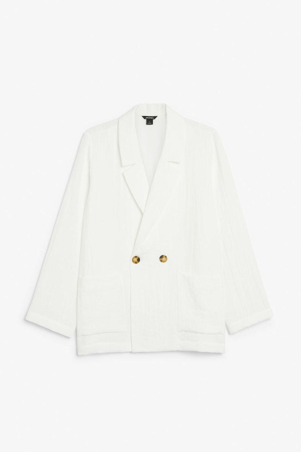 """<p>Everyone needs a blazer in their wardrobe to throw on over a tee and jeans for an instantly 'done' look. We really like this light and airy white version by H&M little sister brand Monki. <a rel=""""nofollow noopener"""" href=""""https://www.monki.com/en_gbp/clothing/coats-jackets/product.double-breasted-blazer-white.0616073001.html"""" target=""""_blank"""" data-ylk=""""slk:Buy here."""" class=""""link rapid-noclick-resp"""">Buy here.</a> </p>"""