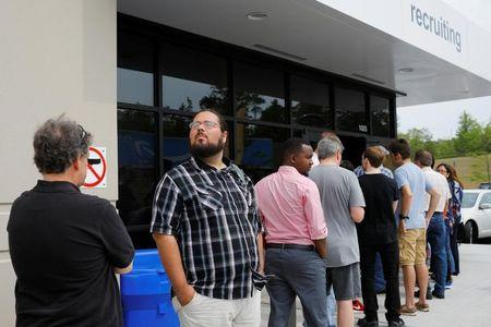 """Job seekers line up to apply during """"Amazon Jobs Day"""" at the Amazon.com Fulfillment Center in Fall River"""