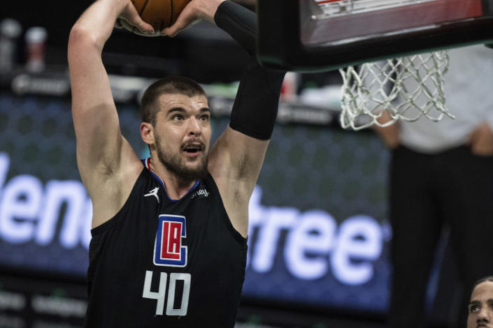 Los Angeles Clippers center Ivica Zubac dunks the ball against the Charlotte Hornets during the first half of an NBA basketball game in Charlotte, N.C., Thursday, May 13, 2021. (AP Photo/Jacob Kupferman)
