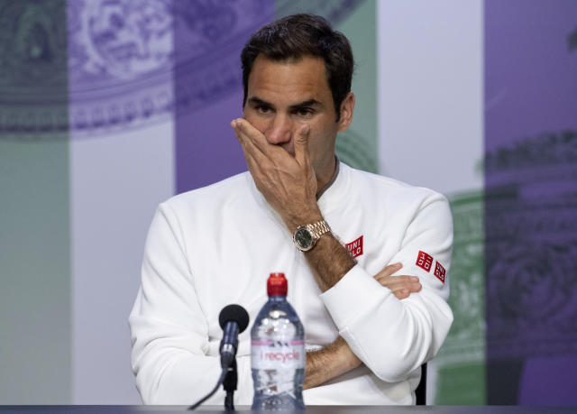 Switzerland's Roger Federer reacts during the press conference following his defeat by Serbia's Novak Djokovic in the men's singles final match of the Wimbledon Tennis Championships in London, Sunday, July 14, 2019. (Joe Toth, AELTC Pool Photo via AP)