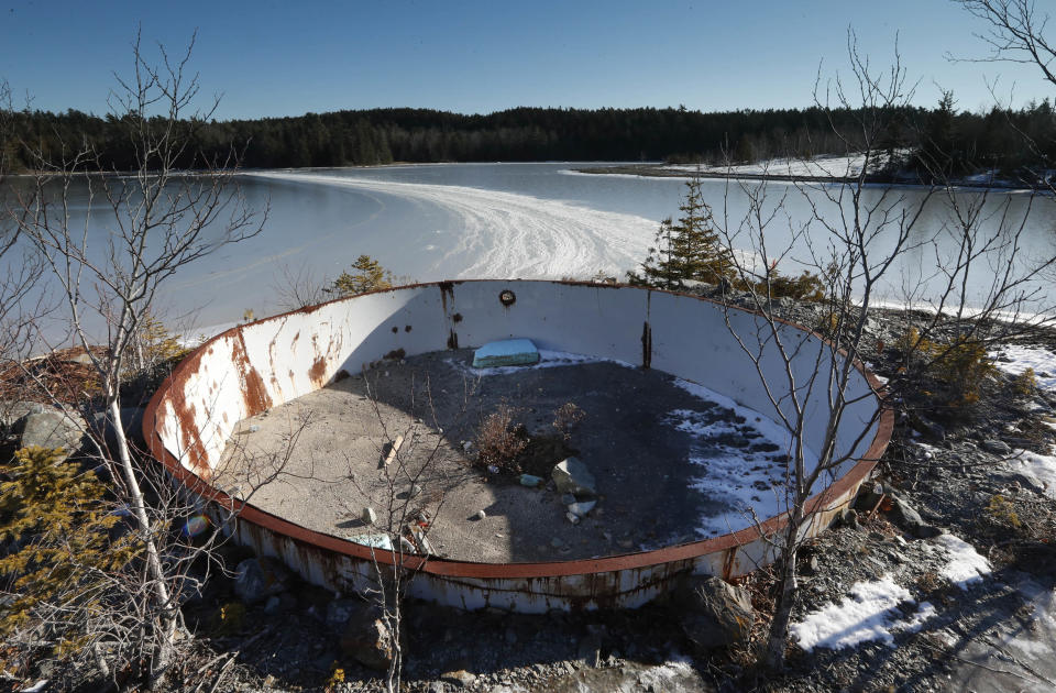 A deteriorating tank sits on the site of the Callahan Mine in Maine in 2016. The former open pit copper and zinc mine is a federal Superfund site. (Robert F. Bukaty / AP file)