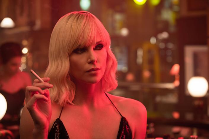 """Directed by David Leitch &bull; Written by Kurt Johnstad<br><br>Starring Charlize Theron, James McAvoy, John Goodman, Toby Jones,&nbsp;Sofia Boutella and&nbsp;Bill Skarsg&aring;rd<br><br><strong>What to expect:&nbsp;</strong>Charlize Theron was stuck barking commands from behind a desk in&nbsp;""""The Fate of the Furious,"""" but in the punk-rock thriller """"Atomic Blonde,"""" she gets to join the action.&nbsp;Theron plays a first-rate spy commissioned to take down a espionage ring during the final days of the Berlin Wall. The movie is based on Antony Johnston's graphic novel """"The Coldest City.""""<br><br><i><a href=""""https://www.youtube.com/watch?v=nI7HVnZlleo"""" rel=""""nofollow noopener"""" target=""""_blank"""" data-ylk=""""slk:Watch the trailer"""" class=""""link rapid-noclick-resp"""">Watch the trailer</a>.</i>"""