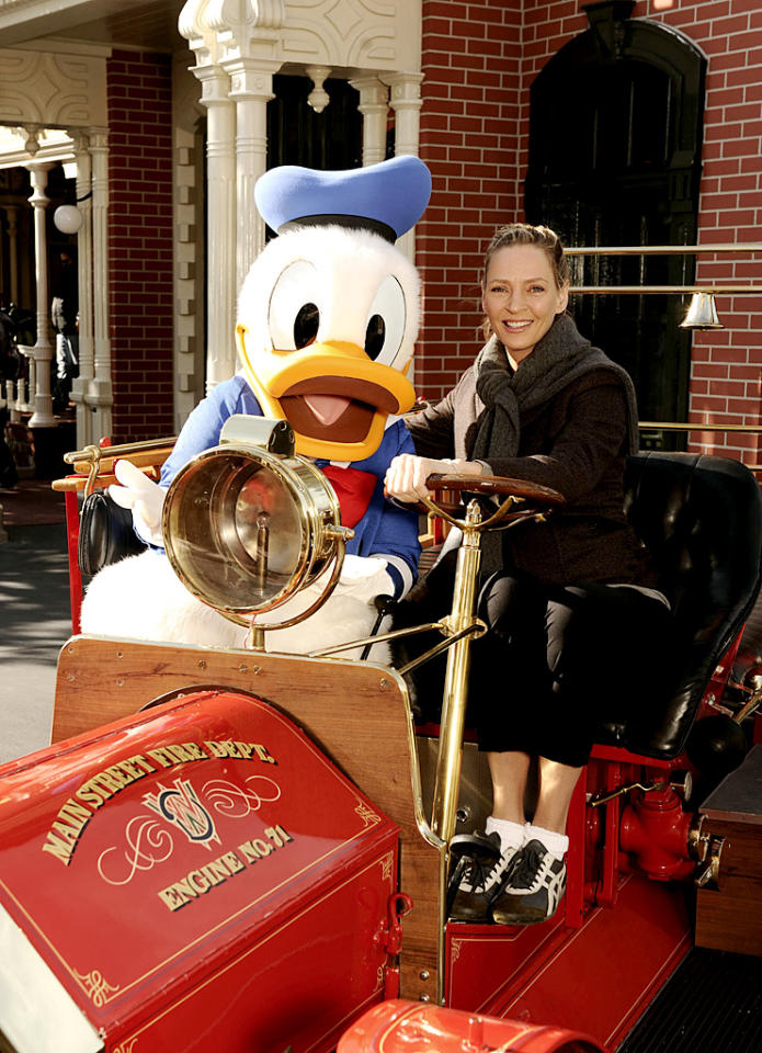 "During a visit to Disney's Magic Kingdom on Sunday, ""Pulp Fiction"" star Uma Thurman took a ride in a replica fire truck with Donald Duck himself. You can catch Uma next in ""Bel Ami,"" a film about a young man's rise to power in Paris, co-starring Robert Pattinson and Christina Ricci. (01/14/2012)."